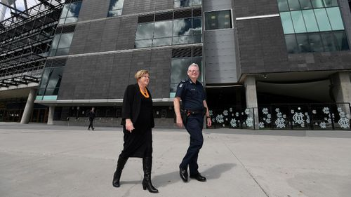 Victorian Minister for Police Lisa Neville and Victoria Police Assistant Commissioner Stephen Leane outside the MCG today.