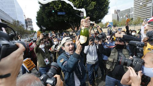People celebrate the victory of President-elect Joe Biden and Vice President-elect Kamala Harris in Los Angeles.