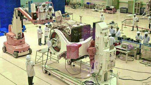 "Scientists work on the orbiter vehicle of ""Chandrayaan-2"" for India's first moon lander and rover mission."