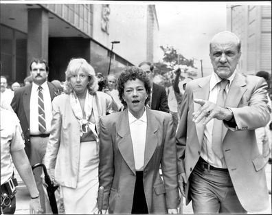 Prosecutors Linda Fairstein (left) and Elizabeth Lederer (right) are escorted from court after summations at lunchtime under heavy security against jeering demonstrators August 06, 1990. (Photo by Michael Norcia/New York Post Archives /(c) NYP Holdings, Inc. via Getty Images)