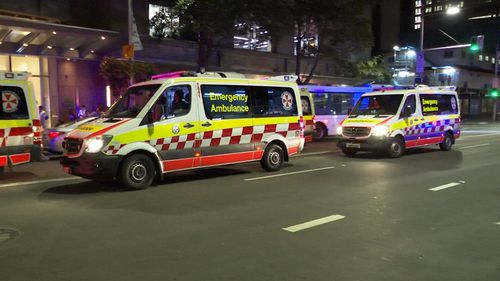 Several ambulance crews attended the scene in Sydney's CBD around 12.30am.