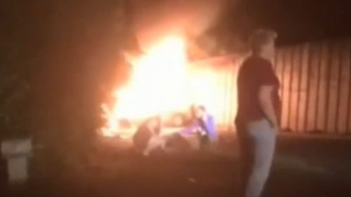 Onlookers captured the fiery wreckage on their phone cameras. (9NEWS)