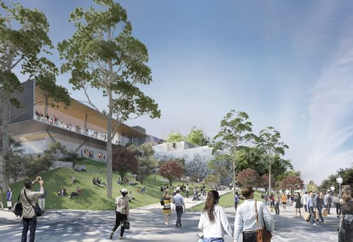 The design includes grassy space and tree-lined paths that lead out to the Yarra River.