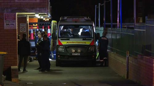 A woman is in a coma after falling from a Cabramatta balcony.