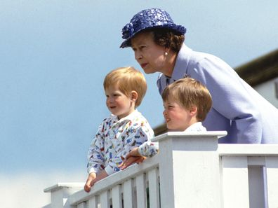 Queen Elizabeth with Prince Harry and Prince William as children.