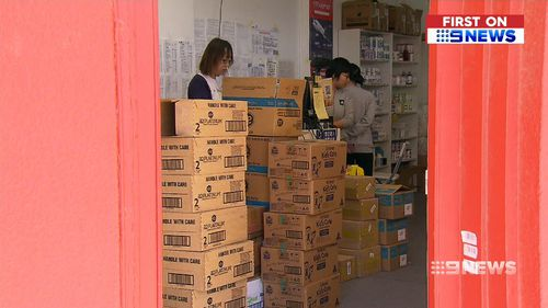 Piles of boxes of the popular A2 formula are being shipping to overseas buyers. (9NEWS)