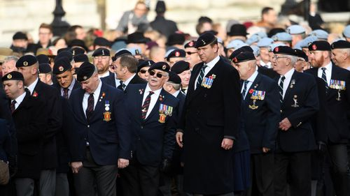 Britain's war veterans march down Whitehall during the Remembrance Sunday service in London, Britain. (AAP)