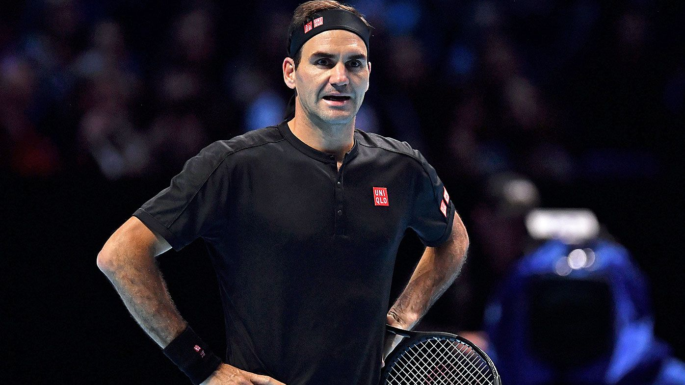 Roger Federer of Switzerland reacts as he questions a line call