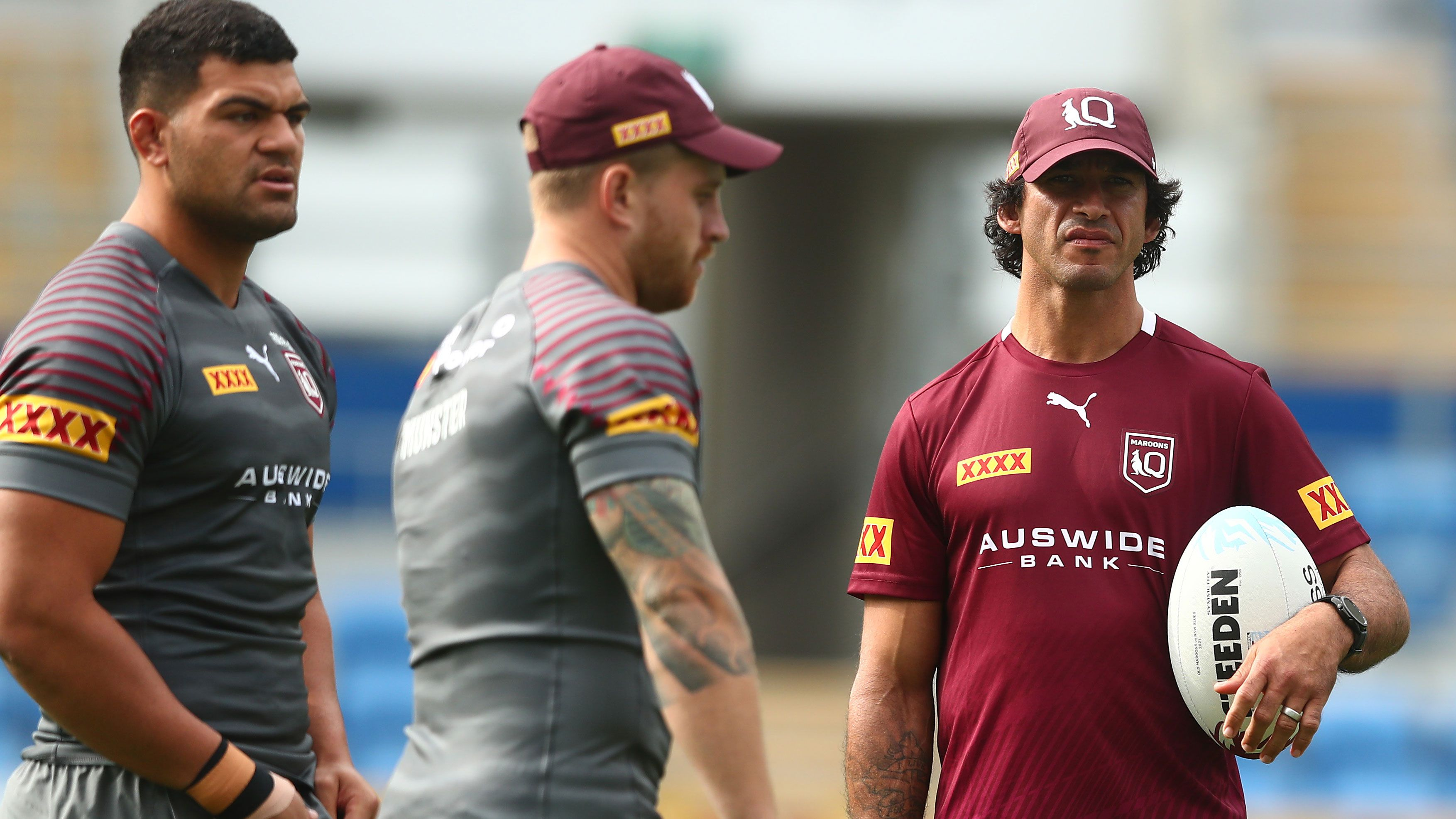 Queensland great Johnathan Thurston watches over a Maroons training session.