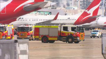 The unidentified substance found on a Qantas flight at Sydney Airport has been deemed to be not suspicious