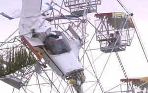 $1.5 million payout for girl trapped on ferris wheel after plane crashed into it