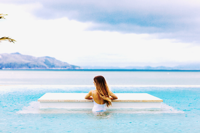 Woman in pool at InterContinental Hayman Island Resort in the Whitsundays