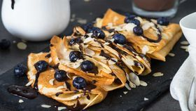 Chocolate crepes with blueberries