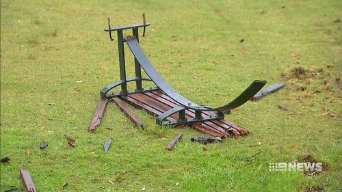 Park benches were ripped up and grass was destroyed before the car crashed into a playground.