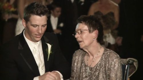 The groom took his mother's hand and danced with her.