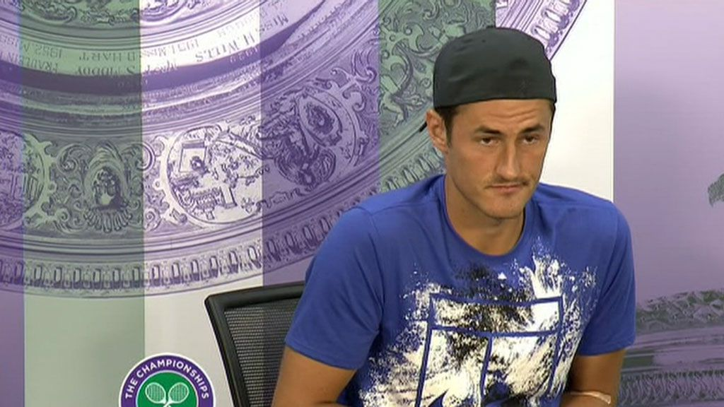 'Bored' Tomic bows out of Wimbledon opener