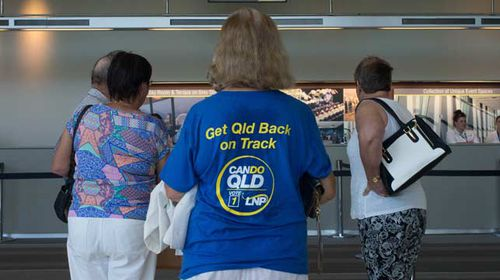 Liberal National Party supporters arrive to register for the official launch of the party's election campaign in Brisbane. (AAP)