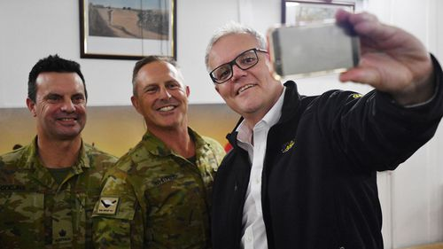 Australian Prime Minister Scott Morrison takes a selfie with Australian troops during a visit to Task Group Taji at Taji Military Complex in Iraq.