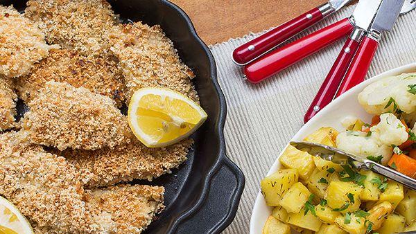 Crunchy fish with potato roasties, vegetables and tartare sauce