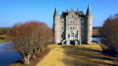 The gorgeous chateau is surrounded by a moat, adding to its grandeur.