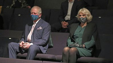Prince Charles and Camilla, Duchess of Cornwall sit in the auditorium with Mayor of London, Sadiq Khan, top, to watch a short rehearsal performance at the Soho Theatre in London