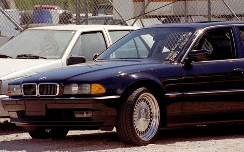 The BMW in which Tupac Shakur died with bullet holes on its wing. (Photo: AP).