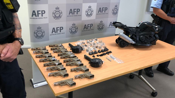 The AFP showcase the array of seized gun parts.