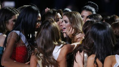 Contestants comforting Miss Colombia Ariadna Gutierrez after the crown and flowers were taken from her and given to Miss Philippines Pia Alonzo Wurtzbach. (AAP)