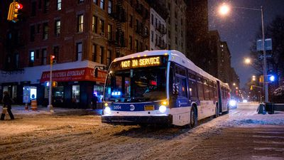 An out of service Metropolitan Transportation Authority bus moves along a snow-covered Broadway in the Upper West Side neighborhood of New York. (AAP)