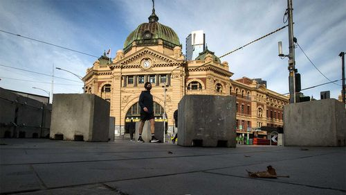 The normally busy intersection of Flinders and Swanston streets outside Flinders Street station in Melbourne.