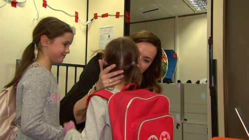 Drop-off and pick-up may no longer be part of the school holidays routine for parents. (9NEWS)