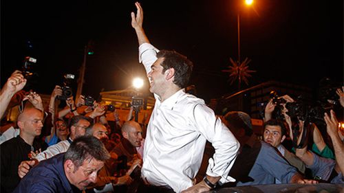 """Greek PM Alexis Tsipras with """"No"""" voters. (AAP)"""