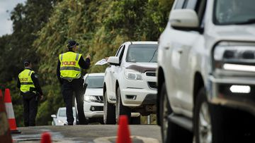Commuters are stopped by police at the Queensland - NSW border checkpoint in the Gold Coast hinterland at Nerang Murwillumbah Road, near Natural bridge.