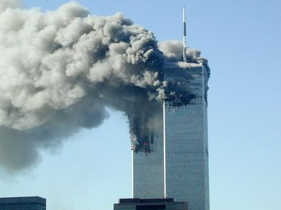 Smoke pours from the World Trade Center after being hit by two planes on the morning of September 11, 2001.