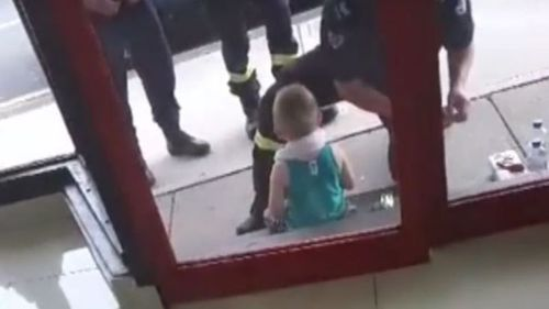 The baby was removed from the car after it was found by passers-by.