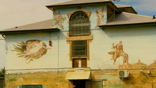 Coloured murals break up the monotony of the jail's brick walls.