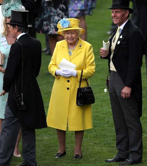 The Queen was resplendent in a yellow Angela Kelly ensemble. Picture: Getty