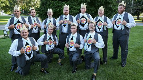 The groom and his groomsmen in their Burger King shirts. (Getty)