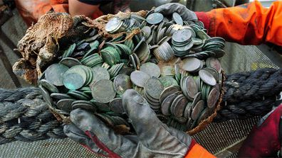 Treasure hunters have salvaged a British ship that was sunk during World War II carrying tonnes of silver coins estimated to be worth millions of dollars.