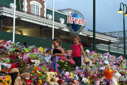A huge floral tribute formed at the gates of Dreamworld after it was forced to close. Picture: AAP