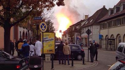 Onlookers stop to take pictures as the blaze encapsulates the Ludwigshaften skies. (Twitter - @reinzeitung)