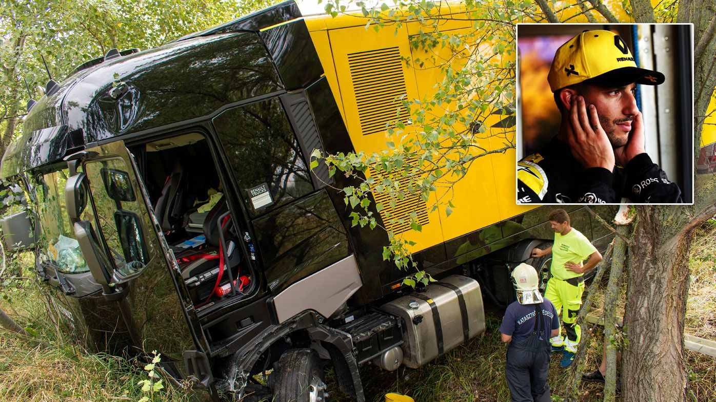 The damaged truck of the F1 Renault team is seen at the 121km section of the M1 motorway after it torn the half-barrier and fell into a ditch near Gyor, Hungary