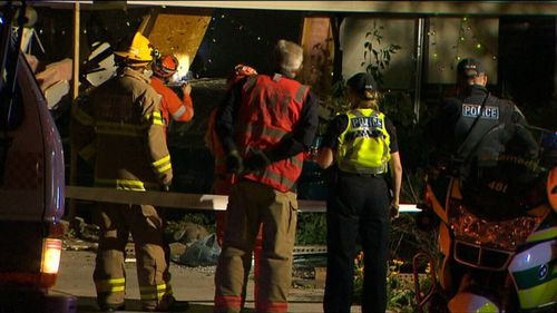Crews worked to stabilise the home after the car crashed into the property.