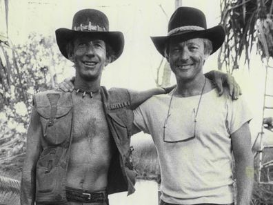 John Cornell, Paul Hogan pose together on the set of Crocodile Dundee in 1984.