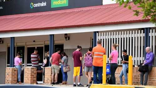 A long queue around a Centrelink office in Brisbane.