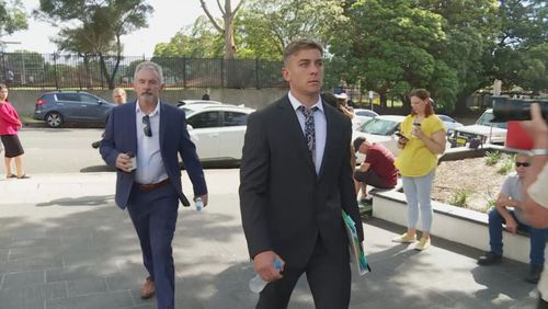 Callan Sinclair (right) outside court. November 19, 2020.