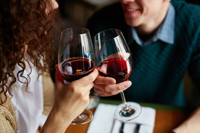 Couple red wine on date