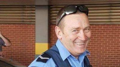 'Courageous' cop's death leaves Australia 'less one hero'