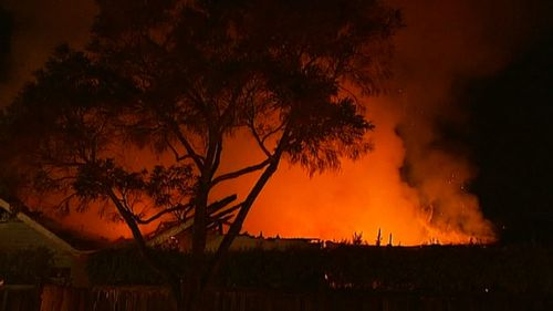 One witness said the house fire looked more like a fierce bushfire. (9NEWS)