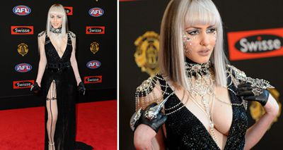 Gabi Grecko bravely donned an all-black, revealing gown to the 2014 Brownlow Medal Awards which she attended with partner Geoffrey Edelsten. (AAP)